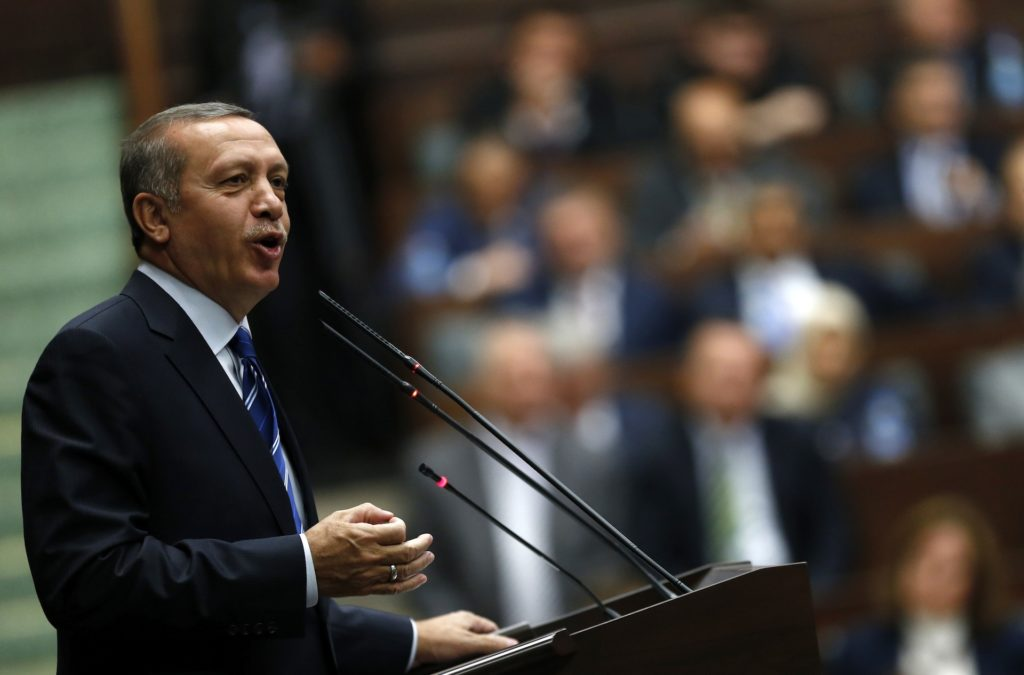 Turkey's Prime Minister Tayyip Erdogan addresses members of parliament from his ruling AK Party (AKP) during a meeting at the Turkish parliament in Ankara April 29, 2014. REUTERS/Umit Bektas (TURKEY - Tags: POLITICS)